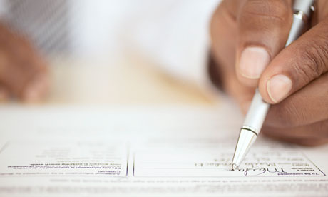 Man's hand signing a contract